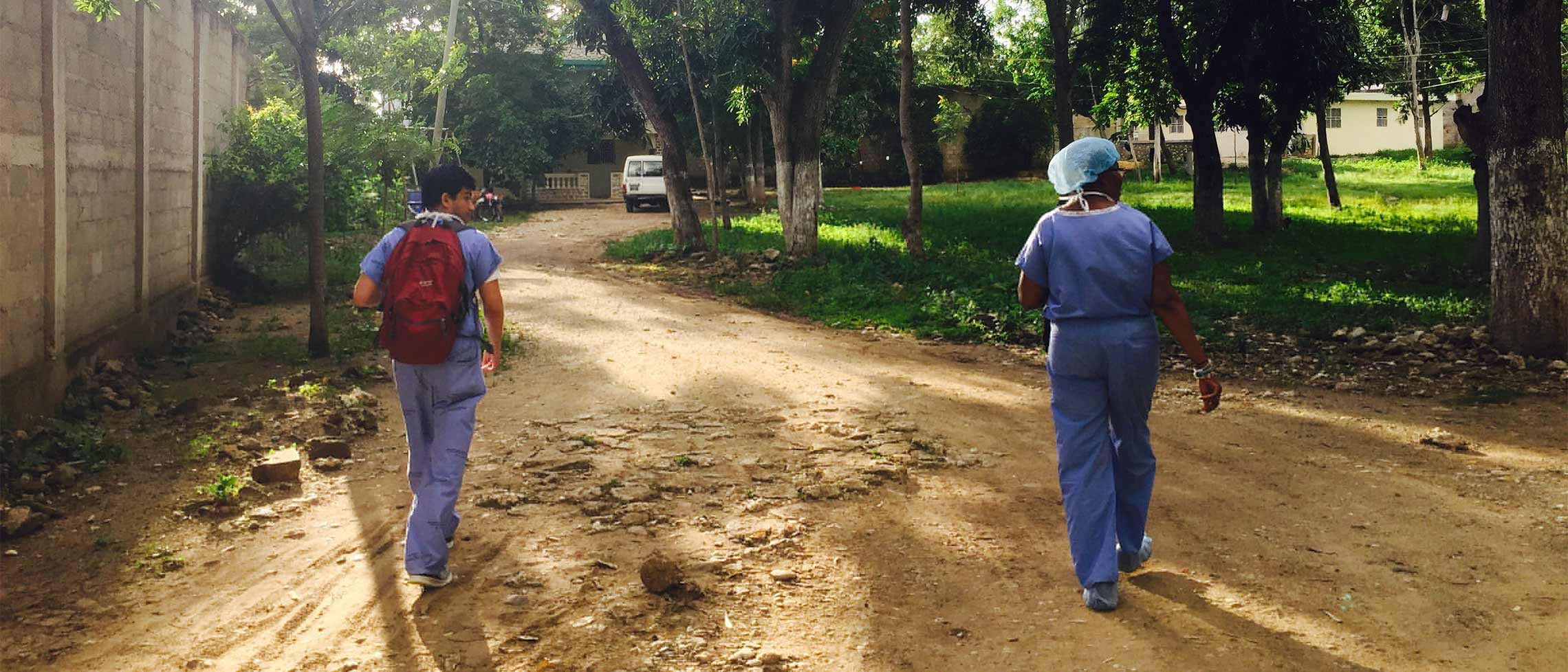 An Emory medical student and nurse walk home from the hospital. Elizabeth Carter, SOM. Haiti.